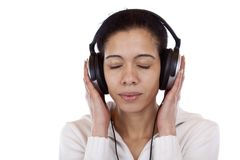Portrait of a pretty woman listening music happily Stock Photo