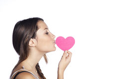 Portrait of pretty woman in love kissing heart Stock Image