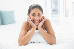 Portrait of a pretty woman lying in bed Royalty Free Stock Photography