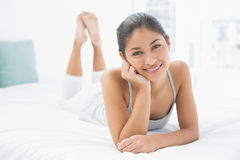 Portrait of a pretty woman lying in bed Royalty Free Stock Images