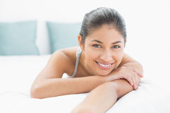 Portrait of a pretty woman lying in bed Royalty Free Stock Photo