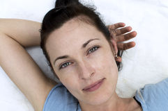 Portrait of pretty woman lying and posing. Portrait of pretty woman lying, posing and looking at camera Stock Photos