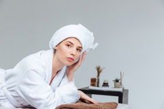Portrait of pretty woman lying in spa salon Royalty Free Stock Photography