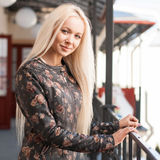 Portrait of pretty woman in the mall. Standing near a railing. Royalty Free Stock Images