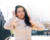 Portrait of a pretty woman outdoors. Looking away Royalty Free Stock Images