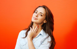 Portrait pretty woman posing against colorful wall Royalty Free Stock Photo