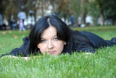 Portrait pretty woman relax nature outdoor park. On the green grass Stock Photography