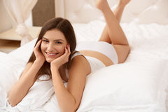 Portrait of a pretty woman relaxing in bed Royalty Free Stock Photography