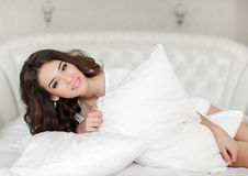 Portrait of a pretty woman relaxing in bed Royalty Free Stock Image