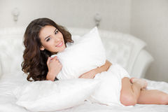 Portrait of a pretty woman relaxing in bed Royalty Free Stock Photos