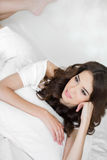 Portrait of a pretty woman relaxing in bed Royalty Free Stock Images