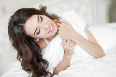 Portrait of a pretty woman relaxing in bed Stock Photo