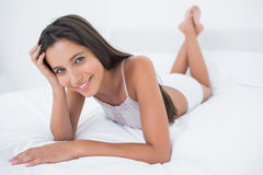 Portrait of a pretty woman relaxing lying in bed Stock Photography