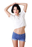 Portrait of pretty woman in short jeans Royalty Free Stock Images