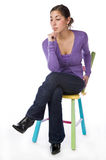 Portrait of an pretty woman sitting on a chair Stock Photos