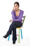 Portrait of an pretty woman sitting on a chair Royalty Free Stock Photo