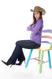 Portrait of an pretty woman sitting on a chair Stock Image