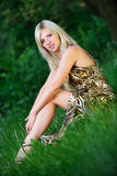 Portrait of a pretty woman sitting in the grass Stock Photography