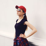 Portrait of pretty woman in sunglasses and cap Royalty Free Stock Photography