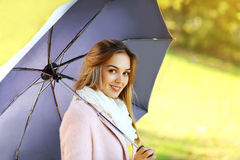 Portrait pretty woman with umbrella in autumn day Royalty Free Stock Images