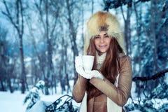 Pretty woman in the winter park stock photo