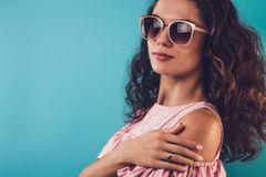 Portrait of a pretty woman wearing sunglasses Stock Images