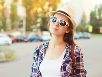 Portrait of pretty woman wearing a sunglasses and straw hat Stock Photos