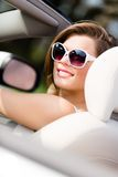Portrait of pretty woman in the white car Royalty Free Stock Photo