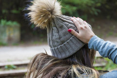 Portrait Of Pretty Woman In Woolen Winter Hat. Outdoor Portrait Of Pretty Woman In Woolen Winter Hat Royalty Free Stock Images