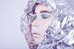 Portrait of pretty woman wrapped in foil looking Royalty Free Stock Images