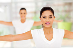 Pretty women stretching Stock Images