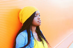 Portrait pretty young african woman over orange background Royalty Free Stock Photography
