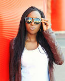 Portrait of pretty young african woman wearing a leather jacket Stock Photography