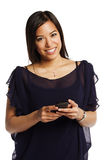 Portrait of a pretty young asian woman texting Royalty Free Stock Photo