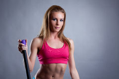 Portrait of pretty young athlete with fitbar Royalty Free Stock Photos