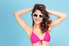 Portrait of a pretty young beach girl wearing sunglasses Royalty Free Stock Photography