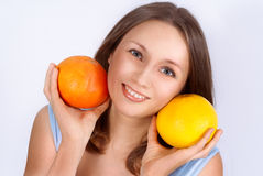 Portrait of pretty young beautiful woman with two grapefruits Stock Photos