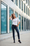 Portrait of pretty young business woman near building Stock Images