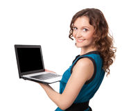 Portrait of a pretty young businesswoman holding a laptop Royalty Free Stock Photos