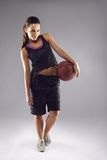 Portrait of pretty young female basketball player Stock Image