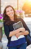 Portrait of Pretty Young Female Student Carrying Books on School Stock Image