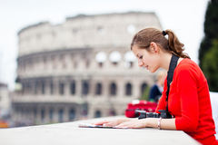 Portrait of a pretty, young, female tourist in Rome, Italy. (with Colosseum in the background stock photo