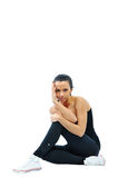 Portrait of pretty young fitness woman sitting Royalty Free Stock Images