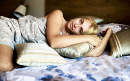 Portrait pretty young girl on bed Royalty Free Stock Image