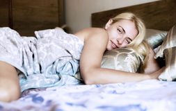 Portrait pretty young girl on bed Royalty Free Stock Images