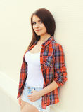 Portrait of pretty young girl in checkered shirt Stock Photos