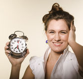 Portrait of pretty young girl with clock Royalty Free Stock Photo