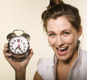 Portrait of pretty young girl with clock Royalty Free Stock Photos