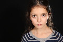 Portrait of a pretty young girl. On a dark background Stock Photos