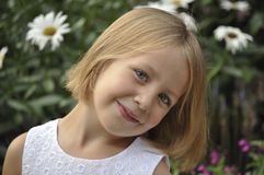 Portrait of pretty young girl in garden Royalty Free Stock Photos